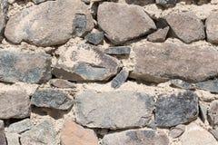 Skały izolują ściskać w cementowych tapetowych naturalnych ciężkich skałach i cegłach tapetowych Fotografia Royalty Free