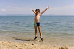 skacz seacoast dziecko Obrazy Royalty Free