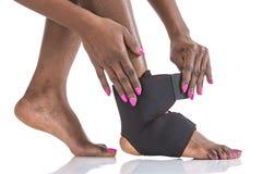 Skada för fot för kompressionsstabilisatorankel arkivbild