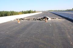 Skadad asfaltväg Royaltyfri Fotografi