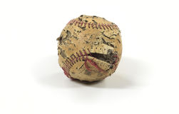 Skadad gammal baseball Arkivfoto