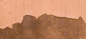 Skadad målad textur för bakgrund för baner för vägg för beigabrunt gammal Royaltyfri Foto