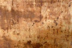Skadad rostig nedfläckad metalltexturbakgrund Arkivfoto