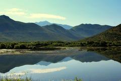 Skadar lake and mountains, Albania. Picture Skadar lake with mountains with azure sky royalty free stock image
