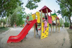 Skadovsk Ukraine - June 22, 2017: Small children have fun on the playground, place for entertainment, recreation and development Stock Photo