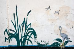 Skadovsk, Ukraine - 15. Juni 2017: Retro- Zeichnung auf der Kalksteinwand: Binse, Reiher, der entlang das Wasser wandert und nach Lizenzfreies Stockbild