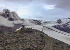 Skaftafellsjokull Glacier: glacier tongue with ice and snow slide down the mountain valley in Skaftafell, South Iceland, Europe. Epic view of Skaftafellsjokull stock image