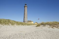 Skagen (Denmark) - Lighthouse Grey Tower. The lighthouse Grenen (called Grey Tower) near Skagen (Denmark, North Jutland) at the junction of Skagerrak (North Sea Royalty Free Stock Images