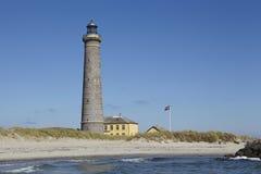 Skagen (Denmark) - Lighthouse Grey Tower. The lighthouse Grenen (called Grey Tower) near Skagen (Denmark, North Jutland) at the junction of Skagerrak (North Sea Stock Photos
