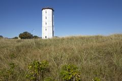 Skagen (Denmark) - Lighthouse White Tower. The lighthouse Skagen (called White Tower) is the former lighthouse to protect the coastal line at the junction of Royalty Free Stock Photos