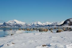 Skagen in snow. View from Skagen, Meløy. You see the sea and the mountains with snow on Royalty Free Stock Photography