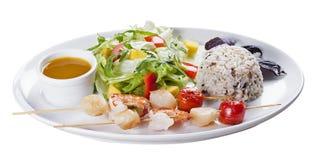 Skaldjur med ris och grönsaker royaltyfria foton