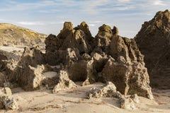 Skalisty wychód na plaży, tworzy ten naturalnego kamień zdjęcia stock