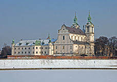 Skalka Sanctuary in winter, Krakow, Poland. Skalka Sanctuary and frozen Vistula river in Cracow, Poland. St. Stanislaus church and Paulinite monastery. Famous stock images