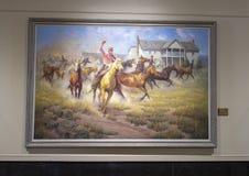 Skall Rogers på hästrygg som målar Claremore, Oklahoma Fotografering för Bildbyråer