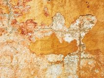skalning av målarfärg och knastrar på en vägg Royaltyfri Bild