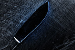Skalpell på den skrapade metallyttersidan Royaltyfri Fotografi
