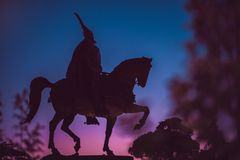 Silhouette of a rider on a horse. Skanderbeg monument in. Skanderbeg, Albanian national hero, monument in Tirana center. Evening sunset sky and a silhouette of Stock Image