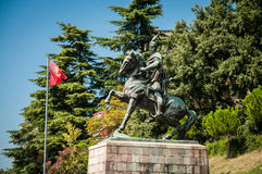 Skanderbeg monument in Kruje. Beautifull moutains behind it Royalty Free Stock Photos