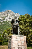 Skanderbeg monument in Kruje. Beautifull moutains behind it Stock Image