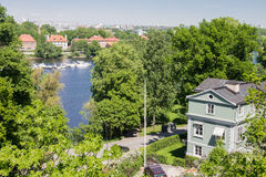Skansen Park Stockholm Sweden. Djurgårdsbrunnskanalen canal with its trees, boats and mansions Royalty Free Stock Photos