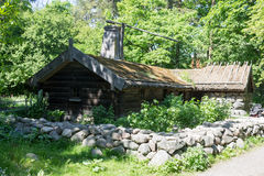 Skansen Park Stockholm Sweden. A typical swedish wood building with a stone fence in Skansen Park Stockholm Sweden Royalty Free Stock Images