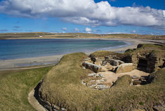 Skara Brae with Bay of Skaill in background Stock Images