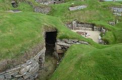 Skara Brae, a Neolithic settlement in the coast of Mainland island, Orkney, Scotland. Skara Brae is a stone-built Neolithic settlement, located on the Bay of royalty free stock image