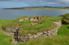 Skara Brae, a Neolithic settlement in the coast of Mainland island, Orkney, Scotland. Skara Brae is a stone-built Neolithic settlement, located on the Bay of stock photo
