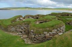 Skara Brae, a Neolithic settlement in the coast of Mainland island, Orkney, Scotland. Skara Brae is a stone-built Neolithic settlement, located on the Bay of stock image