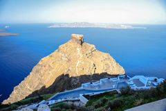 Skaros rock in Santorini against blue sea as a Royalty Free Stock Photos