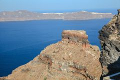 Skaros rock in Santorini against blue sea as a Royalty Free Stock Image