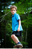 skatboarding的男孩 库存图片