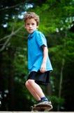 Skatboarding boy. Six year old boy on a skateboard Stock Image