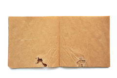 Skatchbook brun ouvert chiffonné Photo stock