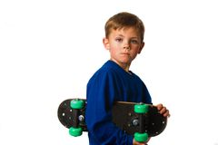 Skate board boy. Young boy holding skate board on white background Royalty Free Stock Images