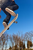 Skate board going airborne Royalty Free Stock Image