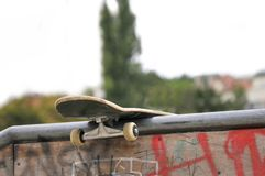 Skate board left behind in park Stock Photography