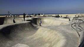 Skate boarders at Venice Beach stock video footage