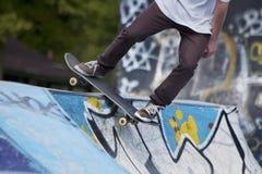 Skate boarding. A guy skate boarding in the skate park Royalty Free Stock Image