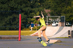 Skate boarding. Skate boarder tries tricks at a local park Stock Photography