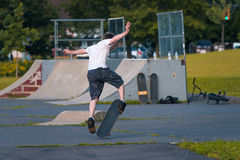Skate boarding. Skate boarder tries tricks at a local park Royalty Free Stock Photo