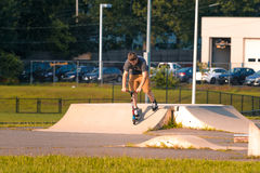 Skate boarding. Skate boarder tries tricks at a local park Stock Photo