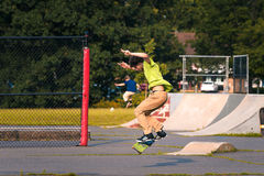Skate boarding. Skate boarder tries tricks at a local park Royalty Free Stock Photography