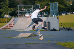 Skate boarding. Skate boarder tries tricks at a local park Royalty Free Stock Image