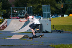 Skate boarding. Skate boarder tries tricks at a local park Royalty Free Stock Images