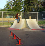 Skate Boarding Teen. Teen at public skateboard park Royalty Free Stock Photography