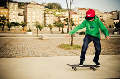 Skate boy. A teenager practicing skate in the street Royalty Free Stock Photos