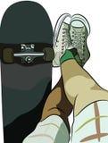 Skate e pés Imagens de Stock