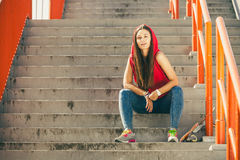 Skate girl on stairs with skateboard. Stock Photography